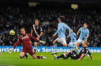 David Silva of Manchester City chips the ball past Mark Schwarzer of Fulham for the second goal - Barclays Premier League - Manchester City vs Fulham - Etihad Stadium - Manchester - 13/01/13 - Picture Simon Bellis/Sportimage .Manchester 19/1/2013 .Football Calcio 2012/2013 Premier League.Manchester City Vs Fulham .Foto Insidefoto .ITALY ONLY