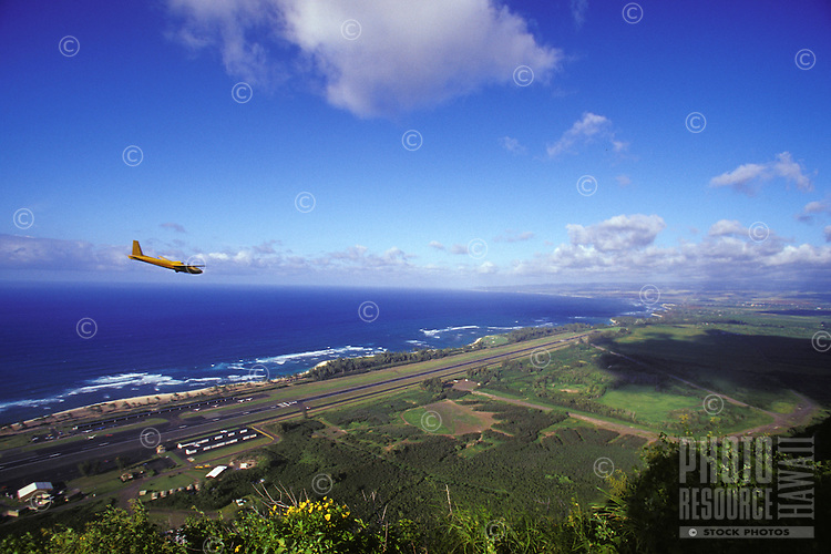 Glider over Dillingham Airfield with Mokuleia and North Shore in background, seen frrom Kealia Trail