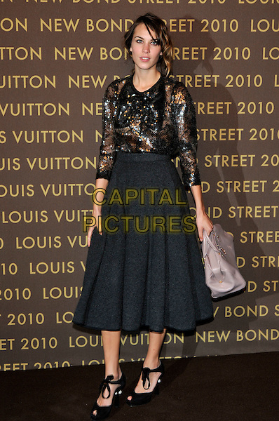 ALEXA CHUNG .attends the launch of the Louis Vuitton Bond Street Maison in London, England, UK, May 25th, 2010..full length grey gray full skirt mid calf beaded top gold silver long sleeve peep toe shoes grey gray bag .CAP/PL.©Phil Loftus/Capital Pictures.
