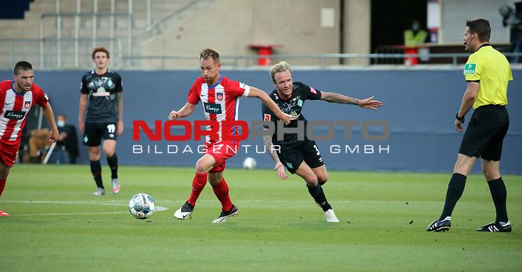 v.l. Marc Schnatterer (1. FC Heidenheim), Kevin Vogt (SV Werder Bremen)<br /> <br /> Deutschland, Heidenheim, 06.07.2020, Fussball, Bundesliga, Saison 2019/2020, Relegation, 1. FC Heidenheim - SV Werder Bremen :nphgm001: 06.07.2020<br /> <br /> DFL/DFB REGULATIONS PROHIBIT ANY USE OF PHOTOGRAPHS AS IMAGE AND/OR QUASI-VIDEO<br /> <br /> Foto: Pressefoto Rudel/Robin Rudel/Pool/gumzmedia/nordphoto