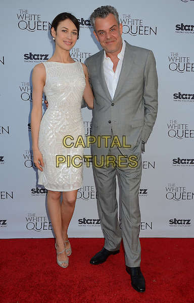 Olga Kurylenko &amp; Danny Huston<br /> Dame Barbara Hay hosts a reception for Starz original show &quot;The White Queen&quot; by best selling author Philipa Gregory in Los Angeles, CA., USA.<br /> July 25th, 2013<br /> full length white sleeveless dress sequins sequined shirt grey gray suit couple<br /> CAP/ADM/BT<br /> &copy;Birdie Thompson/AdMedia/Capital Pictures