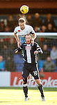 Clint Hill wins the ball in the air from Liam Boyce
