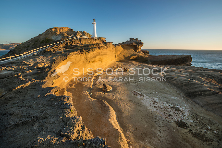 Rocky cliffs and Castlepoint lighthouse, Wairarapa, New Zealand- stock photo, canvas, fine art print