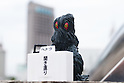 Film character Hedorah bows in deep apology during a press conference on September 14, 2016, Tokyo, Japan. Japanese toy maker Bandai created a series of four monsters called the ''Godzilla Toho Monsters Press Conference'' marketed as vending machine capsule toys. The model monsters are bowing in front of a press stand expressing their formal apologies for acts of destruction in the country. They are on sale for 300 Yen (approx USD 2.92) each. (Photo by Rodrigo Reyes Marin/AFLO)