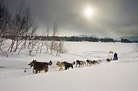 Jason Barron team leaves Finger Lake Chkpt past Iditarod Trail Sign Finger Lake Alaska 2006 Iditarod
