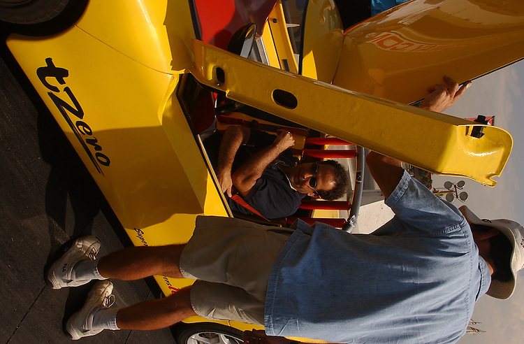 Experimental electric sports car T-Zero at the California Speedway in Fontana,  CA 3 September 2003.(Photo for The NYT/Gerard Burkhart)..Actor Tony Shaloub checksthe T Zero then takes it for a spin...Engineer Allen Cocconi (Floppy white hat) helps shaloub...