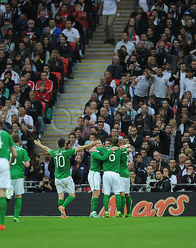 29.05.2013 London, England. Republic of Ireland players surround Shane Long after he scored the opening goal in the International Friendly between England and Republic of Ireland from Wembley Stadium.