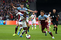 Wilfried Zaha of Crystal Palace and Aaron Cresswell of West Ham United during West Ham United vs Crystal Palace, Premier League Football at The London Stadium on 5th October 2019