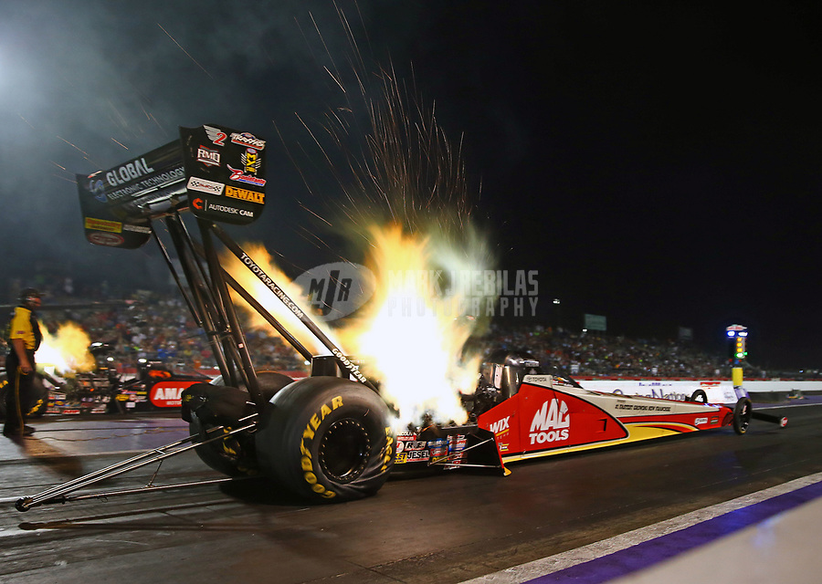 Apr 21, 2017; Baytown, TX, USA; NHRA top fuel driver Doug Kalitta launches off the starting line during qualifying for the Springnationals at Royal Purple Raceway. Mandatory Credit: Mark J. Rebilas-USA TODAY Sports