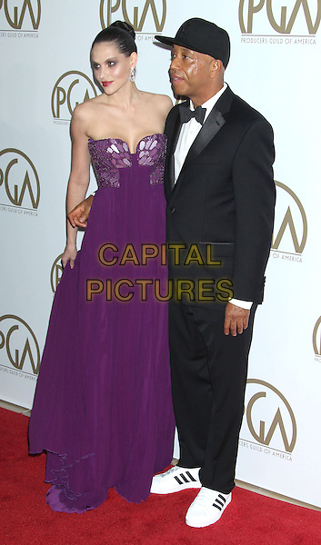 Hana Nitsche & Russell Simmons.At the 24th Annual Producers Guild Awards held at the Beverly Hilton Hotel, Beverly Hills, California, USA,.26th January 2013..PGAs PGA arrivals full length black tuxedo hat baseball cap bow tie  purple strapless dress couple profile  .CAP/ADM/RE.©Russ Elliot/AdMedia/Capital Pictures.