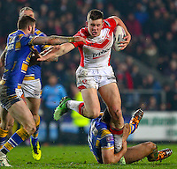 Picture by Alex Whitehead/SWpix.com - 28/03/2014 - Rugby League - First Utility Super League - St Helens v Leeds Rhinos - Langtree Park , St Helens, England - St Helens' Joe Greenwood is tackled by Leeds' Zak Hardaker and Ryan Hall.