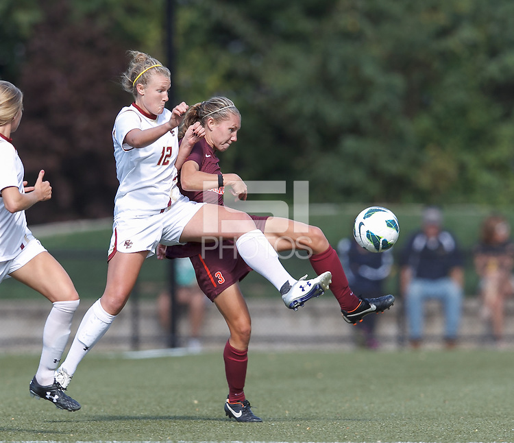 Virginia Tech midfielder Katie Yensen (3) attempts to control the ball as Boston College midfielder Jana Jeffrey (12) pressures.Virginia Tech (maroon) defeated Boston College (white), 1-0, at Newton Soccer Field, on September 22, 2013.