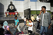 Travellers arrive outside the busy New Delhi Railway Station in New Delhi, India. Photo: Sanjit Das/Panos