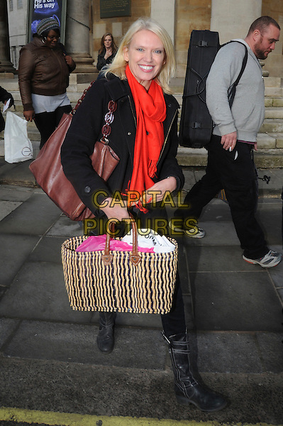 ANNEKA RICE.Out shopping in London, England, UK, 11th December 2010..full length red scarf bag basket black boots brown coat leggings .CAP/IA.©Ian Allis/Capital Pictures.