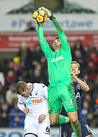 Goalkeeper Lukasz Fabianski of Swansea City  gathers as Harry Kane of Spurs & Alfie Mawson of Swansea City look on during the Premier League match between Swansea City and Tottenham Hotspur at the Liberty Stadium, Swansea, Wales on 2 January 2018. Photo by Mark Hawkins / PRiME Media Images.