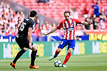 Juanfran Torres of Atletico de Madrid (R) in action against Jose Angel Cote of SD Eibar (L) during the La Liga match between Atletico Madrid and Eibar at Wanda Metropolitano Stadium on May 20, 2018 in Madrid, Spain. Photo by Diego Souto / Power Sport Images