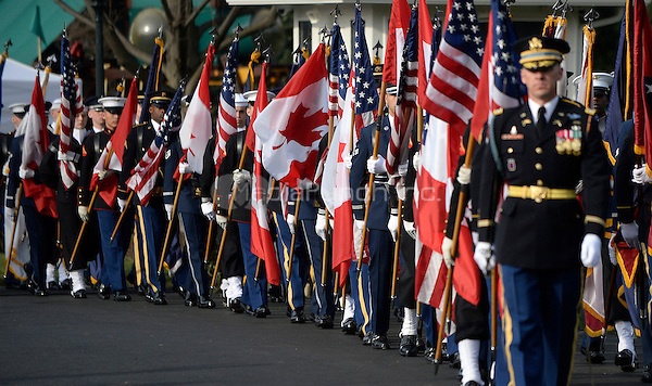 Honor guards carry US and Canadian flags at the White House as part of the official Arrival Ceremony opening the Official Visit of Prime Minister Justin Trudeau and Mrs. Sophie Gr&Egrave;goire Trudeau of Canada on the South Lawn of the White House in Washington, DC on Thursday, March 10, 2016. <br /> Credit: Olivier Douliery / Pool via CNP/MediaPunch