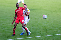 Sammy Ameobi of Nottingham Forest vies for possession with Connor Roberts of Swansea City during the Sky Bet Championship match between Swansea City and Nottingham Forest at the Liberty Stadium in Swansea, Wales, UK. Saturday 14 September 2019
