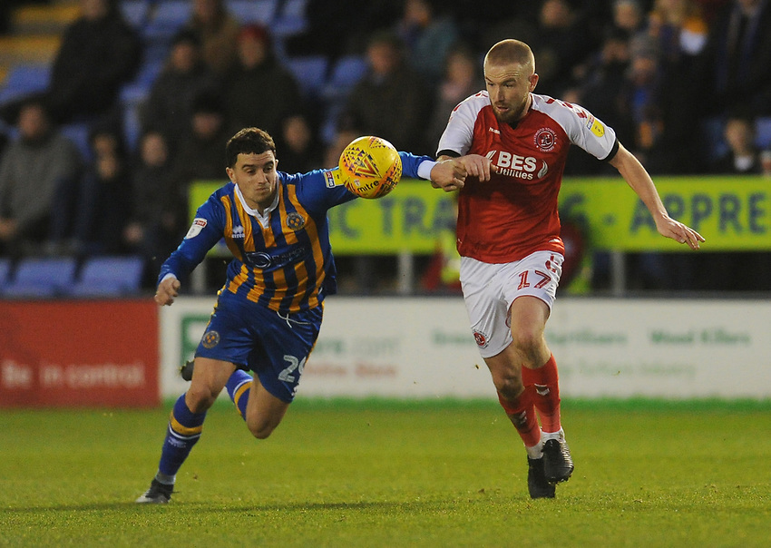 Fleetwood Town's Paddy Madden vies for possession with Shrewsbury Town's Oliver Norburn<br /> <br /> Photographer Kevin Barnes/CameraSport<br /> <br /> The EFL Sky Bet League One - Shrewsbury Town v Fleetwood Town - Tuesday 1st January 2019 - New Meadow - Shrewsbury<br /> <br /> World Copyright © 2019 CameraSport. All rights reserved. 43 Linden Ave. Countesthorpe. Leicester. England. LE8 5PG - Tel: +44 (0) 116 277 4147 - admin@camerasport.com - www.camerasport.com