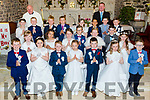 Pupils of Ardfert NS who made their First Holy Communion on Saturday in St Nrendan's Church,Ardfert with the pupils are Tomás O hAinifín (teacher) and Fr Comer.