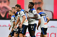 Duvan Zapata of Atalanta BC celebrates with team mates after scoring the goal of 1-1 during the Serie A football match between AC Milan and Atalanta BC at stadio Giuseppe Meazza in Milano ( Italy ), July 24th, 2020. Play resumes behind closed doors following the outbreak of the coronavirus disease. <br /> Photo Image Sport / Insidefoto