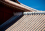 Photo shows the gently sloping roofs of two adjoining buildings at Shuri-jo Castle in Naha, Okinawa Prefecture, Japan, on June 24, 2012. Photographer: Robert Gilhooly