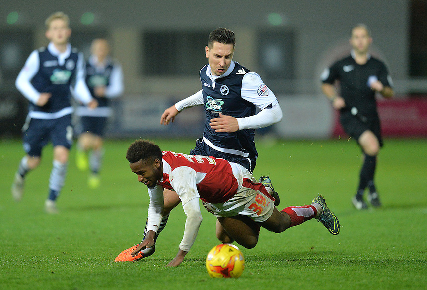 Fleetwood Town's Tariqe Fosu is fouled by Millwall's Joe Martin<br /> <br /> Photographer Dave Howarth/CameraSport<br /> <br /> Football - The Football League Sky Bet League One - Fleetwood Town v Millwall - Tuesday 24th November 2015 - Highbury Stadium<br /> <br /> &copy; CameraSport - 43 Linden Ave. Countesthorpe. Leicester. England. LE8 5PG - Tel: +44 (0) 116 277 4147 - admin@camerasport.com - www.camerasport.com