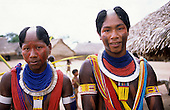 Bacaja Village, Brazil. Two warriors of the Xicrin Kayapo tribe in full face and body paint and with bead and shell adornments.