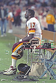 Washington Redskins quarterback Doug Williams (17) watches the action while the defense is on the field during the game against the Dallas Cowboys at RFK Stadium in Washington, D.C. on November 5, 1988.  The Redskins lost the game 13 - 3. <br /> Credit: Ron Sachs / CNP