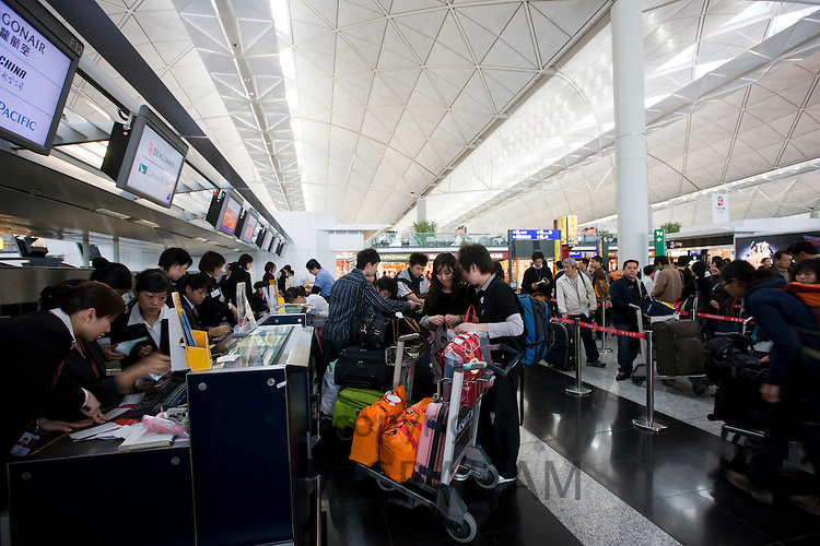 Passengers at check-in desks, Hong Kong International Airport, China