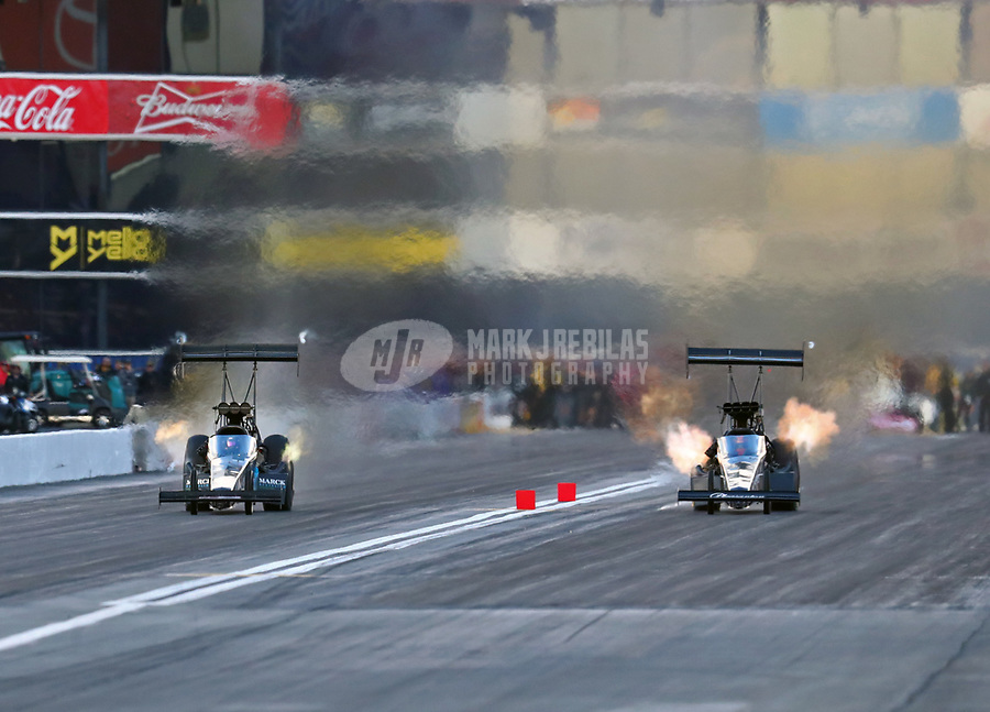 Feb 9, 2019; Pomona, CA, USA; NHRA top fuel driver Mike Salinas (right) races alongside Scott Palmer during qualifying for the Winternationals at Auto Club Raceway at Pomona. Mandatory Credit: Mark J. Rebilas-USA TODAY Sports