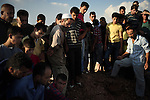 TAL RIFAT: August 1st 2012:..Onlookers watch the burial of an FSA commander in a cemetery in Tal Rifat, a liberated town in Aleppo province. ..Ayman Oghanna for The Sunday Telegraph