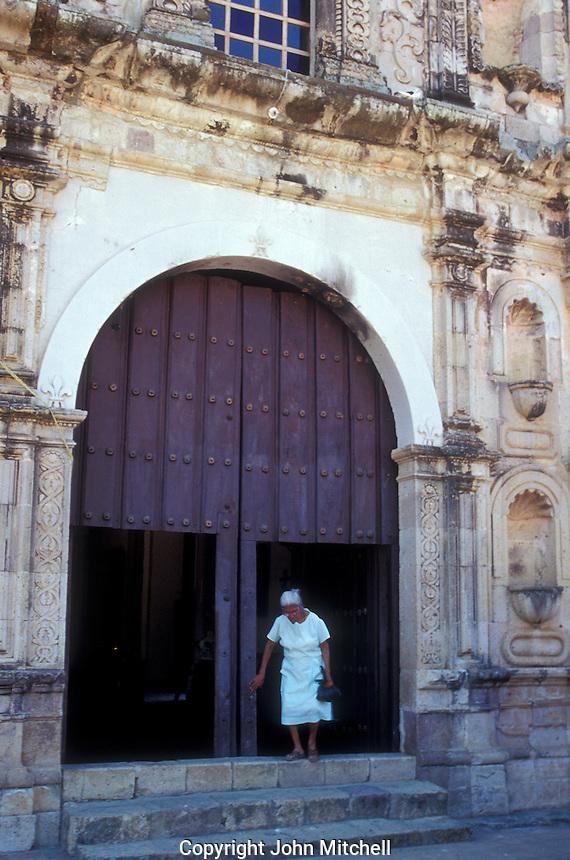 Elderly woman exiting the 18th-century Church of San Jose in the old Spanish colonial mining town of Copala near Mazatlan, Sinaloa, Mexico..