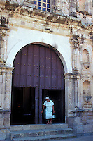 Elderly woman exiting the 18th-century Church of San Jose in the old Spanish colonial mining town of Copala near Mazatlan, Sinaloa, Mexico..