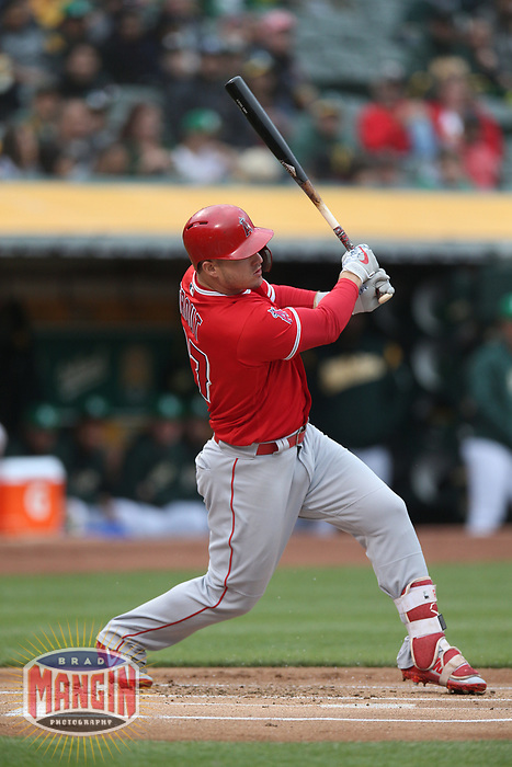 OAKLAND, CA - JUNE 15:  Mike Trout #27 of the Los Angeles Angels of Anaheim bats against the Oakland Athletics during the game at the Oakland Coliseum on Friday, June 15, 2018 in Oakland, California. (Photo by Brad Mangin)