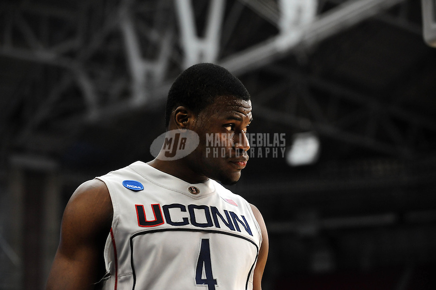 Mar 28, 2009; Glendale, AZ, USA; Connecticut Huskies forward Jeff Adrien against the Missouri Tigers during the finals of the west regional in the 2009 NCAA mens basketball tournament at the University of Phoenix Stadium. The Huskies defeated the Tigers 82-75 to advance to the final four. Mandatory Credit: Mark J. Rebilas-