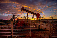 An oil well at sunset on the Cimarron National Grassland in Western Kansas.