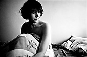 Wroclaw 11.2009 Poland<br /> Transsexual Marina Till at home.<br /> Marina Till, a transsexual, has had numerous medical examinations and treatments, such as a very intense hormonal therapy, at times seriously weakening her organism. For a long time she has been dreaming  about a sex change surgery that she can not afford. She does not accept herself and her body. Frequent suicide attempts and alcohol abuse, are means of escape from the body she lives in. A body that does not belong to her.<br /> Photo: Adam Lach / Napo Images<br /> <br /> Transseksualista Marina Till w swoim domu.<br /> Transseksualista Marina Till przeszla juz setki kuracji hormonalnych i badan psychoterapeutycznych, ktore w znaczny sposob wycienczyly jej organizm. Od wielu lat marzy o zmianie plci lecz najzwyczajniej nie stac ja na zbyt kosztowna operacje. Nie akceptuje siebie, nie akceptuje swojego ciala. Czeste proby samobojcze i znaczne ilosci alkoholu sa dla niej sposobem na ucieczke, przede wszystkim od swiadomosci ze cialo w ktorym zyje nie nalezy do niej.<br /> Fot: Adam Lach / Napo Images
