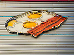 Skooter's Diner. Neon eggs and bacon.