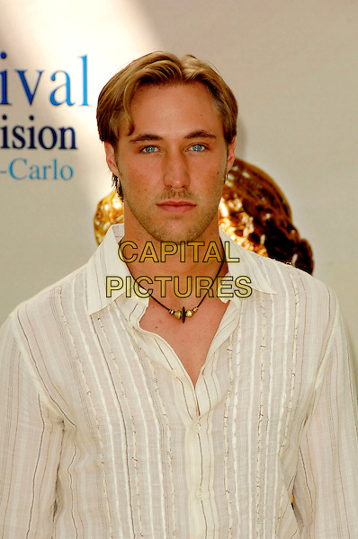 "KYLE LOWDER .Photocall promoting the television series ""Amour Gloire et Beaute (The Bold and the Beautiful)"" on the third day of the 2008 Monte Carlo Television Festival held at Grimaldi Forum, Monaco, Principality of Monaco..June 10th, 2008.half length white shirt cream .CAP/TTL .© TTL/Capital Pictures"