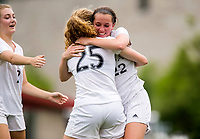 NWA Democrat-Gazette/JASON IVESTER<br /> Siloam Springs junior Audrey Maxwell (right) hugs junior Megan Hutto after scoring off an assist from Hutto Friday, May 19, 2017, against Russellville at Razorback Field in Fayetteville during the 6A state championship game.