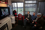 Gala Fairydean Rovers 4, Gretna 1, 25/01/2020. Netherdale, Scottish Lowland League. A group of men in the boardroom watching a Ripping Yarns sketch on television before Gala Fairydean Rovers host Gretna 2008 in a Scottish Lowland League match at Netherdale, Galashiels. The home club were established in 2013 through a merger of Gala Fairydean, one of Scotland's most successful non-League clubs, and local amateur club Gala Rovers. The visitors were a 'phoenix' club set up in the wake of the collapse of the original club, which had competed for a short time in the 2000s before going bankrupt. The home aside won this encounter 4-1 watched by a crowd of 120. Photo by Colin McPherson.