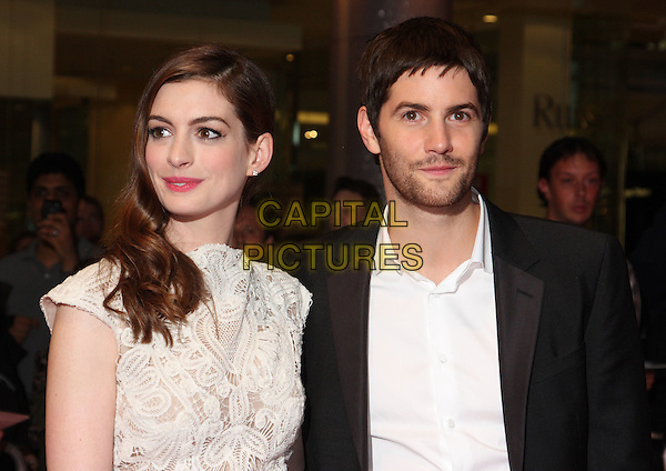 "ANNE HATHAWAY (in Alexander McQueen) & JIM STURGESS.""One Day"" UK premiere, Vue Westfield cinema, Westfield Shopping Centre, London, England..August 23rd, 2011.half length white sleeveless crochet lace dress embroidered shirt black suit stubble facial hair.CAP/ROS.©Steve Ross/Capital Pictures"