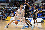 December 19, 2016:  Air Force center, Frank Toohey #33, works his way to the basket during the NCAA basketball game between the University of Colorado Buffaloes and the Air Force Academy Falcons, Clune Arena, U.S. Air Force Academy, Colorado Springs, Colorado.  Colorado defeats Air Force 75-68.