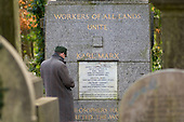 A visitor pays his respects at the tomb of Karl Marx in Highgate Cemetery, London.