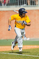 Mike Krische (3) of the Canisius Golden Griffins hustles down the first base line against the Charlotte 49ers at Hayes Stadium on February 23, 2014 in Charlotte, North Carolina.  The Golden Griffins defeated the 49ers 10-1.  (Brian Westerholt/Four Seam Images)