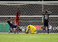 Steve Cronin (1) of D.C. United has a goal scored on him by Danny Koevermans (14) and Andy Iro (3) of Toronto FC during the game at RFK Stadium in Washington, DC.  D.C. United tied Toronto FC, 3-3.