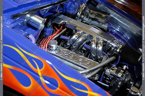 Shiny chromic engine of a Hot Rod Chevrolet Pro-Street S-10 1986 blue retro pickup truck closeup