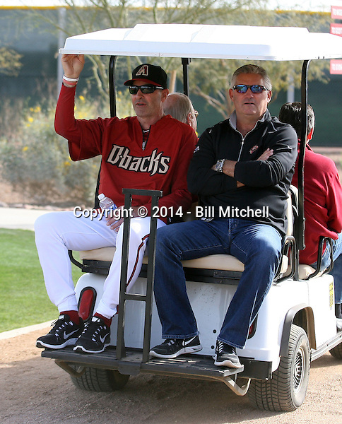 Manager Kirk Gibson (L), General Manager Kevin Towers (R) of the Arizona Diamondbacks participates in the first day of spring training workouts at Salt River Fields on February 7, 2014 in Scottsdale, Arizona (Bill Mitchell)