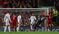 2nd January 2020; Anfield, Liverpool, Merseyside, England; English Premier League Football, Liverpool versus Sheffield United; Liverpool goalkeeper Alisson catches a cross challenged by David McGoldrick of Sheffield United - Strictly Editorial Use Only. No use with unauthorized audio, video, data, fixture lists, club/league logos or 'live' services. Online in-match use limited to 120 images, no video emulation. No use in betting, games or single club/league/player publications